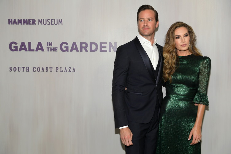 Armie Hammer (L), wearing and Elizabeth Chambers