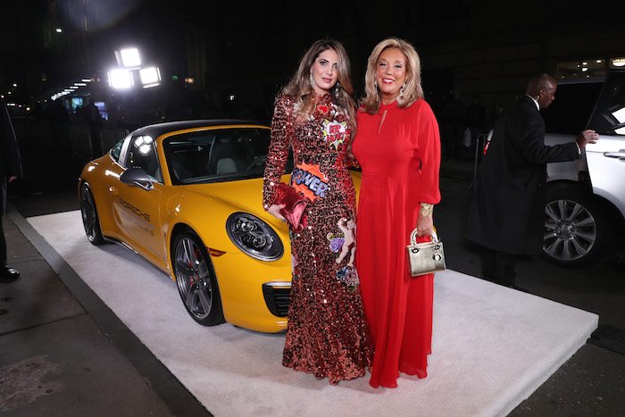 Daniella Rich Kilstock and Denise Rich pose with a Porsche 911 Speedster at the 2018 Angel Ball hosted by Gabrielle's Angel Foundation at Cipriani Wall Street on October 22, 2018 in New York City.