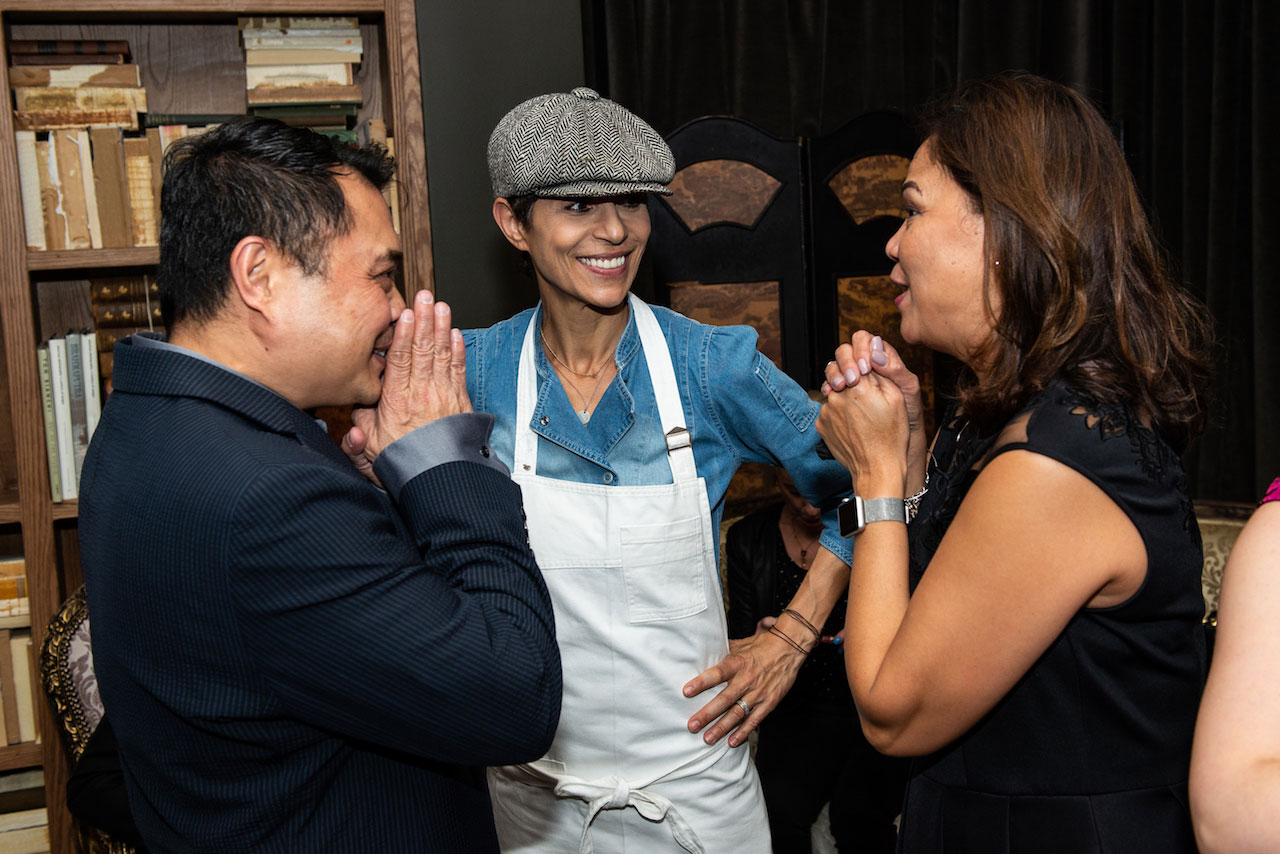 Chef Dominique Crenn, center, with guests at the Cristal event
