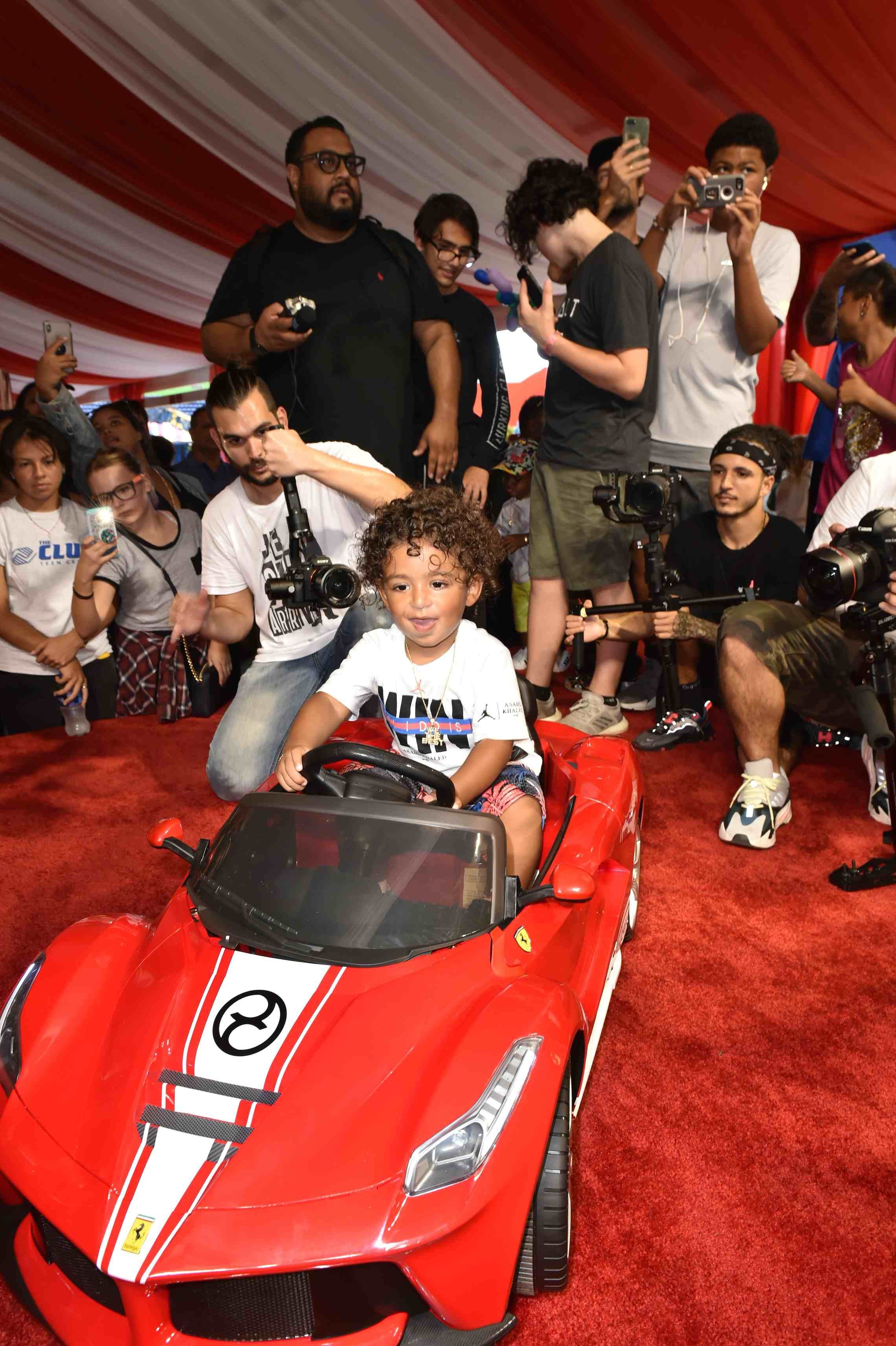 Asahd Khaled in toy Ferrari from Cybex