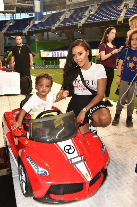 Angela Simmons and her son in Cybex LaFerrari