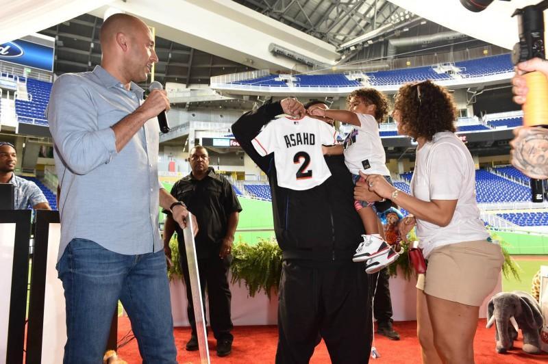 Derek Jeter presenting Asahd custom Marlins jersey