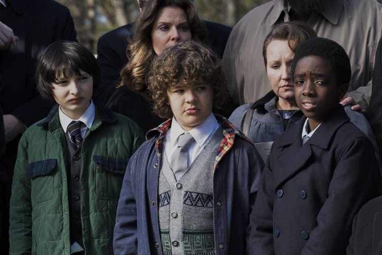 "Buono with Gaten Matarazzo, Caleb McLaughlin and Finn Wolfhard in ""Stranger Things"""