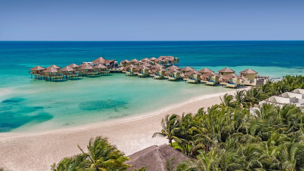 White sandy beaches surround Palafitos