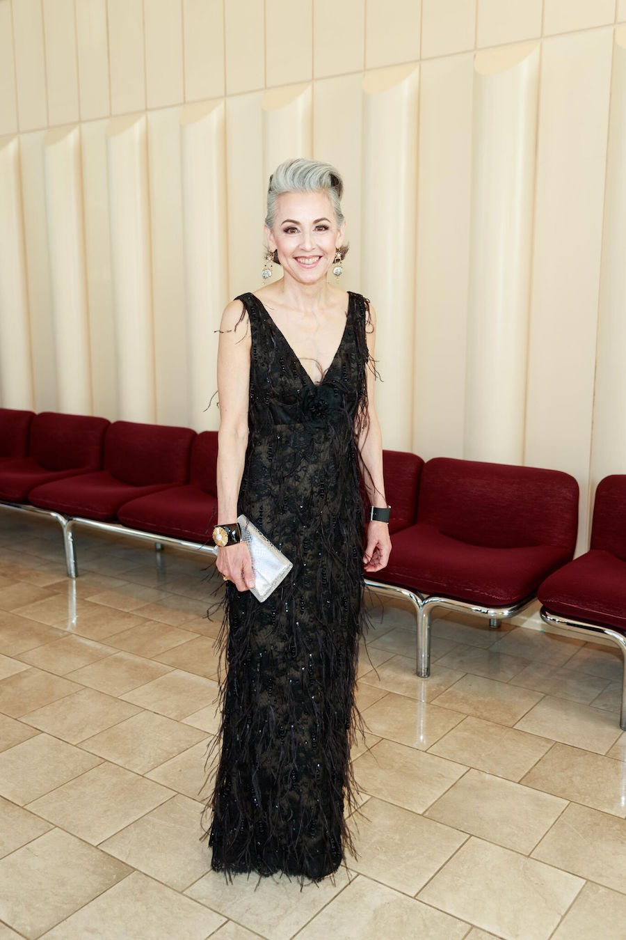 "Kinney says, ""Sako Fisher's Oscar de la Renta feather and beaded dress with Chanel gold and black rhinestone encrusted platform pumps was insane."""