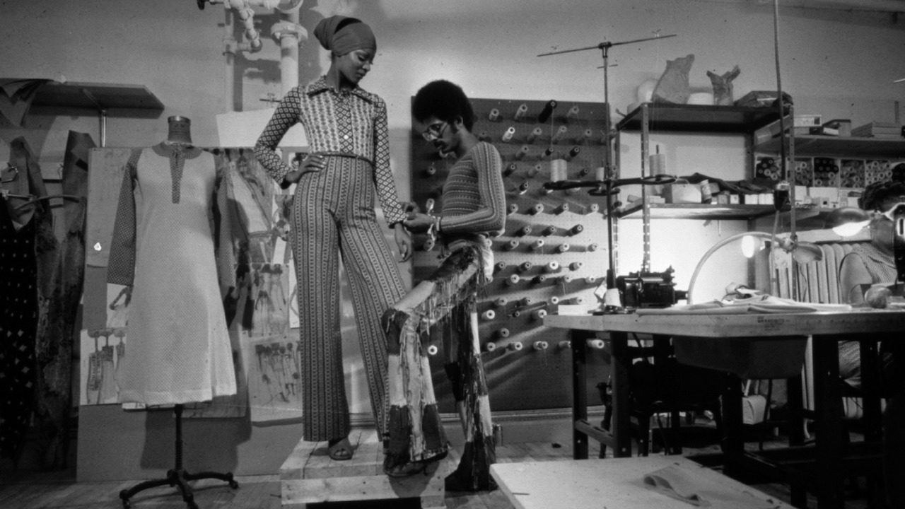 Stephen Burrows and a model at a boutique in 1973