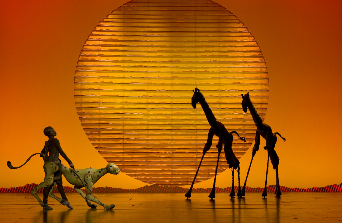 """The Cheetah"" and ""Giraffes"" in the opening number ""The Circle of Life"" from THE LION KING North American Tour"