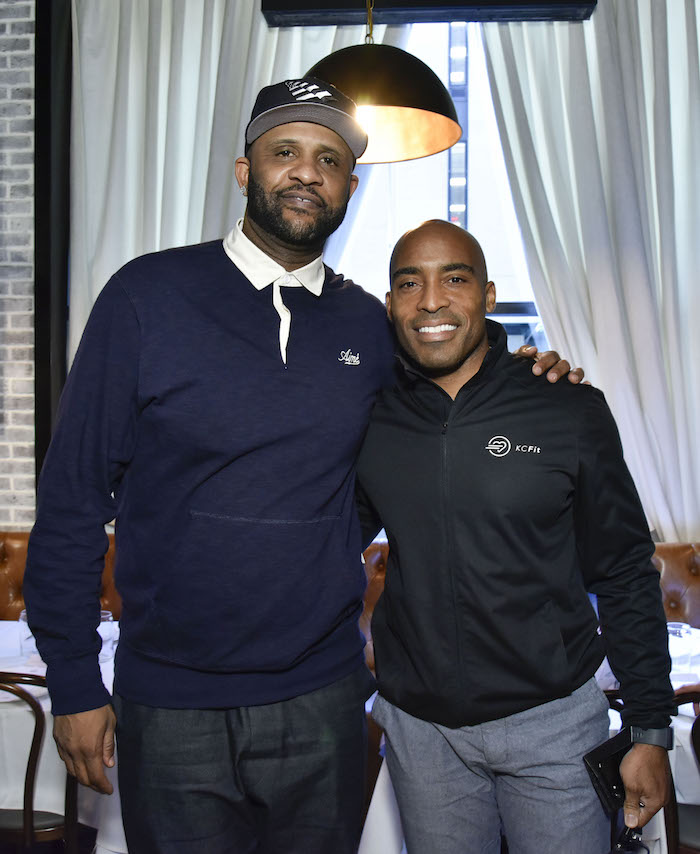 CC Sabathia and Tiki Barber attend the Amber And CC Sabathia Cheer On Team 52 Marathon With Haute Living, Armani Casa And Brooklyn Chophouse on November 3, 2018 in New York City.