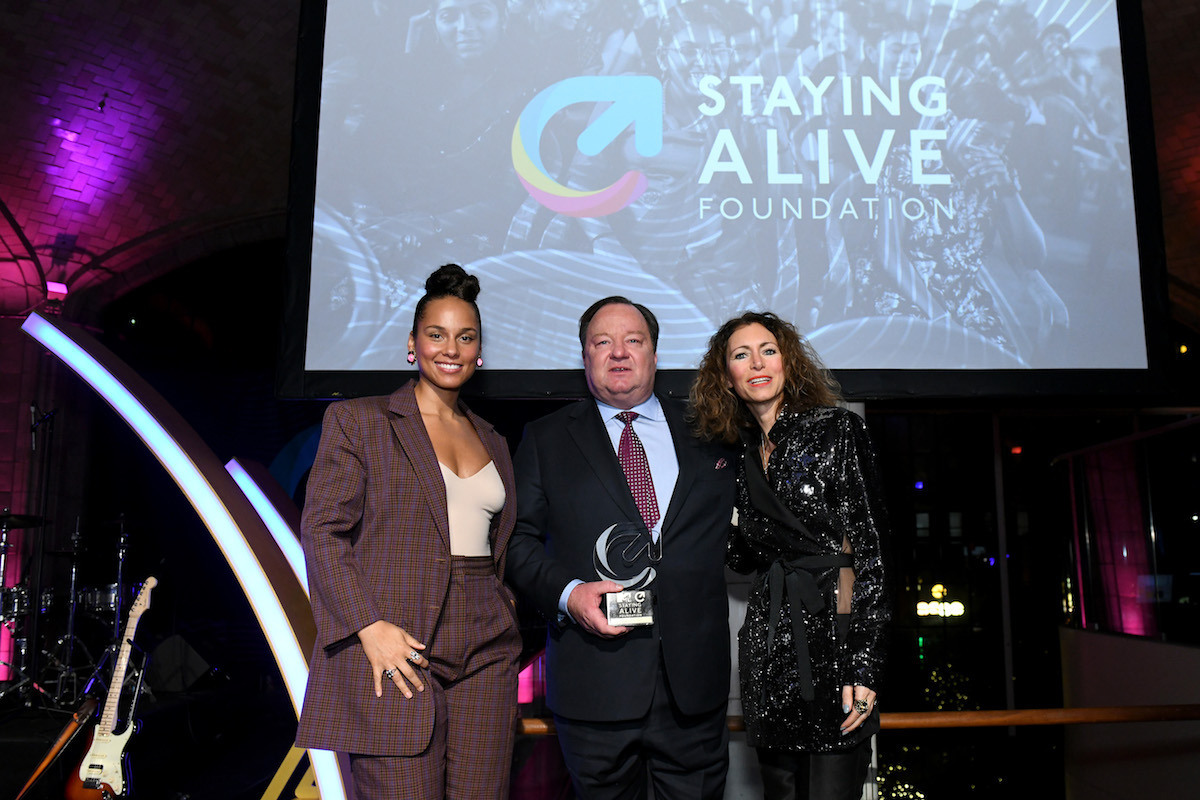 Alicia Keys, Bob Bakish, and Georgia Arnold pose onstage during the MTV Staying Alive Foundation 20th Anniversary Gala at Guastavino's on November 27, 2018 in New York City.