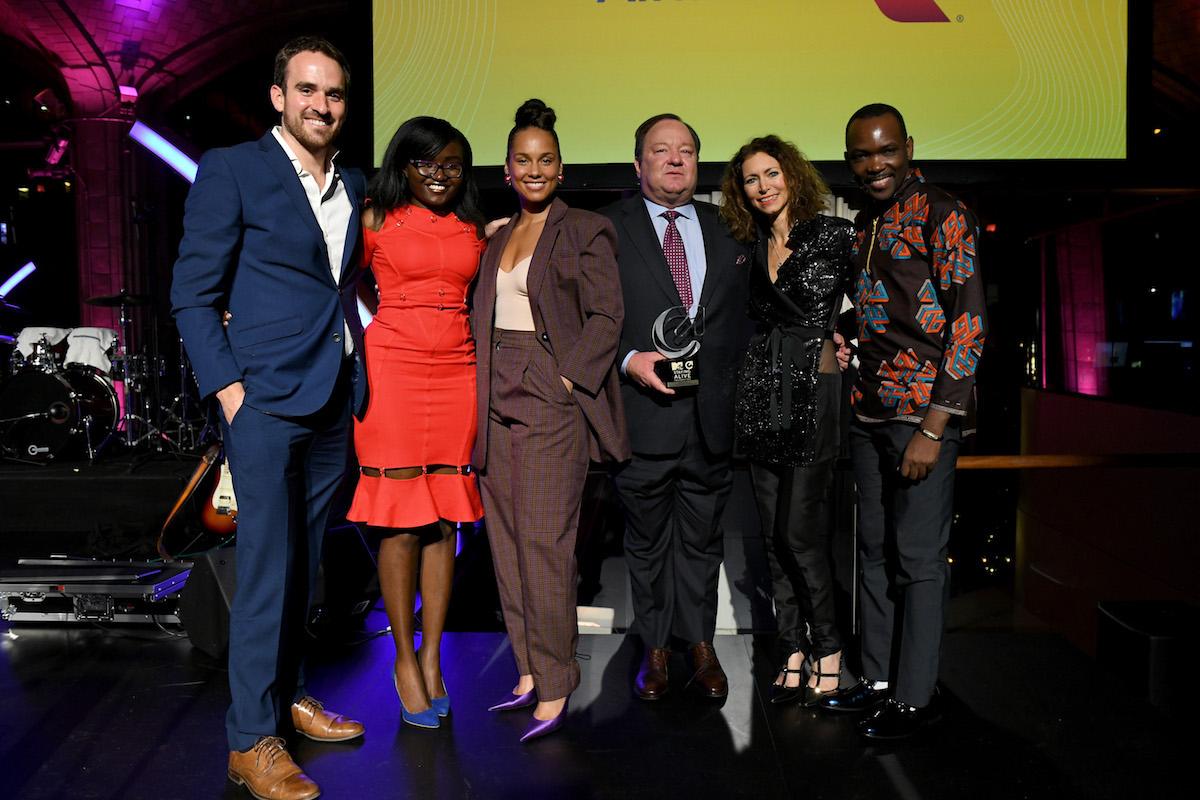 Tyler Spencer, Shirley Sabrina Oruko, Alicia Keys, Bob Bakish, Georgia Arnold, and Henry Luyombya pose onstage during the MTV Staying Alive Foundation 20th Anniversary Gala at Guastavino's on November 27, 2018 in New York City.