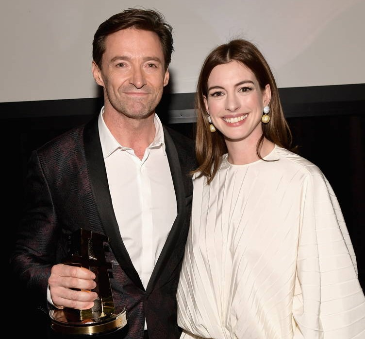 Hugh Jackman, recipient of the Hollywood Actor Award for 'The Front Runner' and Anne Hathaway