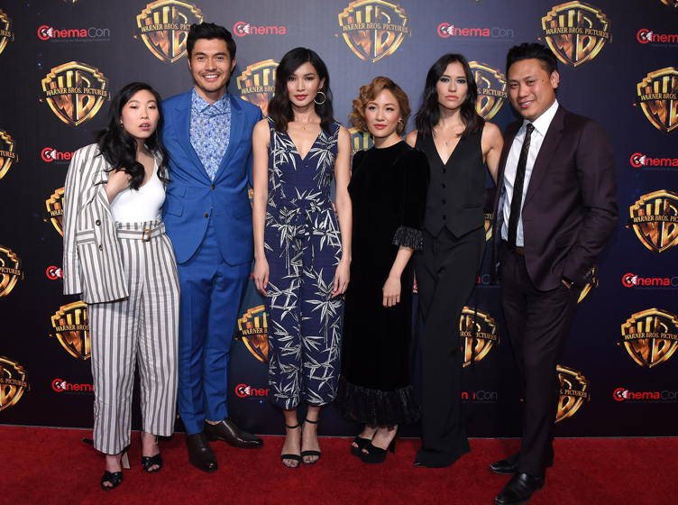"""Crazy Rich Asians"" cast members Awkwafina, Henry Golding, Gemma Chan, Constance Wu, Sonoya Mizuno and Jon M. Chu arrives for Warner Bros panal at CinemaCon 2018 on April 24, 2018 in Las Vegas, NV"