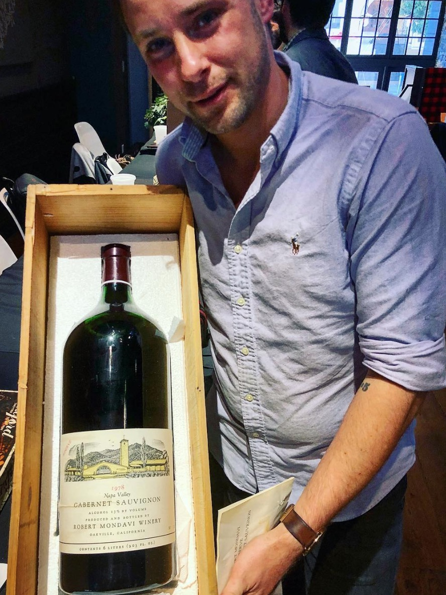 Dulle with a six-liter bottle of Robert Mondavi