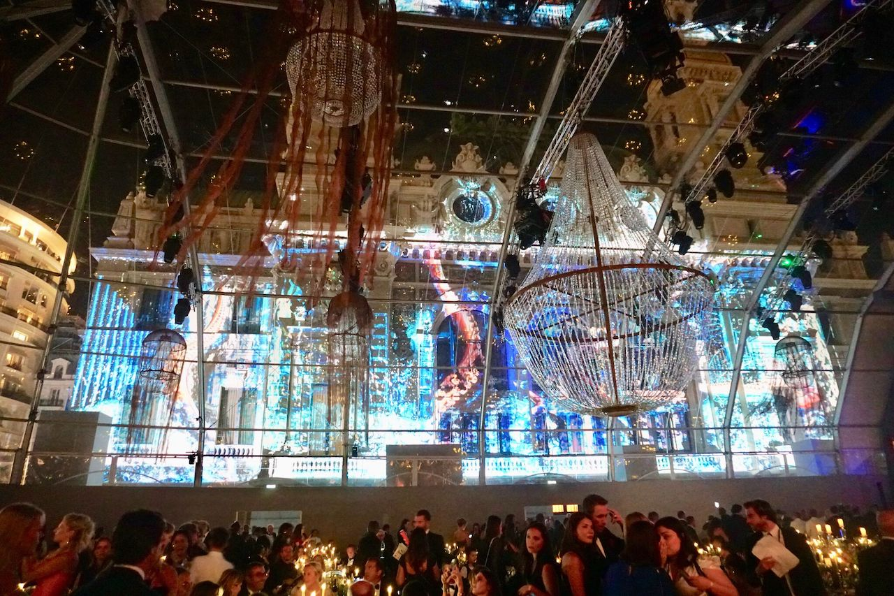 The glass tent showed ocean videos projected on the Opera Garnier
