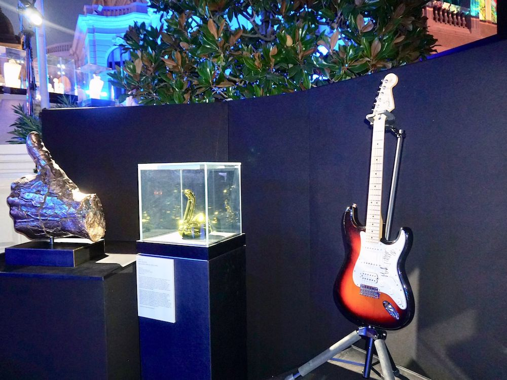 Auction items included Mick Jagger's guitar and a sculpture by Jeff Koons