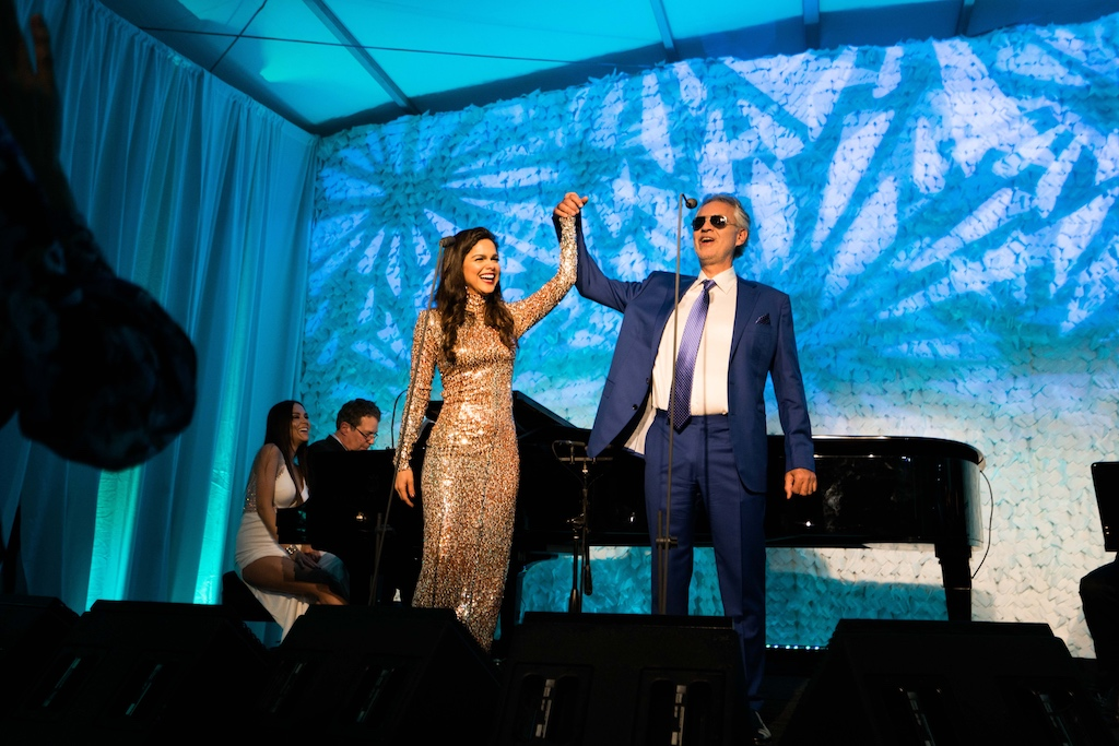 Soprano opera singer Larisa Martinez and Andrea Bocelli take a bow