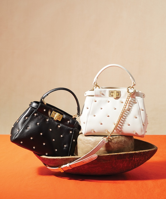 Black Leather XS Peekaboo with Crystal Stars (L); White Leather XS Peekaboo with Crystal Stars (R), $3,890 each