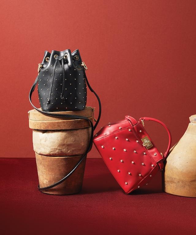 Black Studded Leather Mon Tresor Handbag (L), $1,690; Red Leather XS Peekaboo with Crystal Stars, $3,890