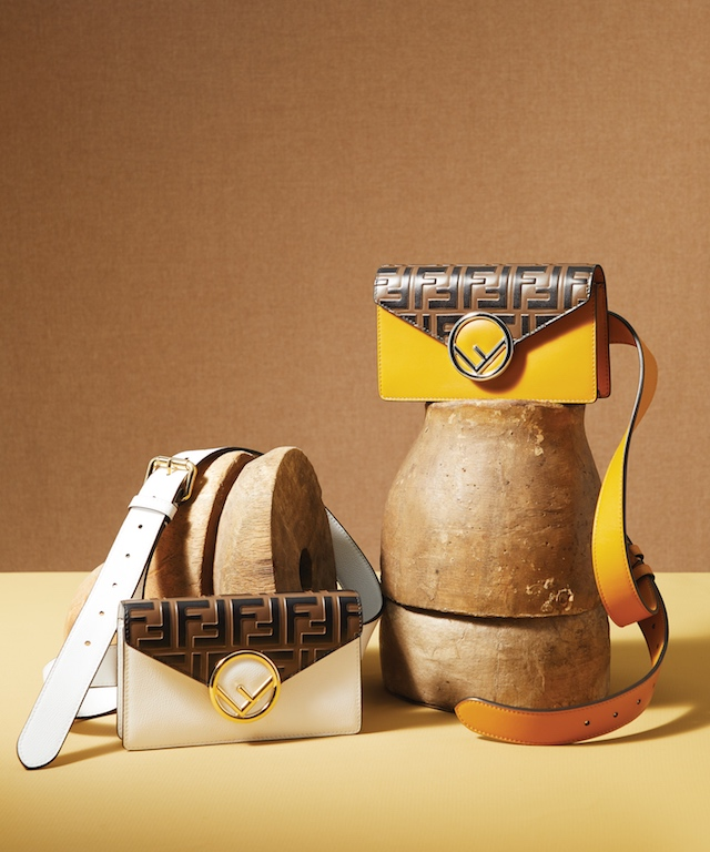 White Leather Belt Pouch (L), $1,190; Yellow Leather Belt Pouch (R), $1,290