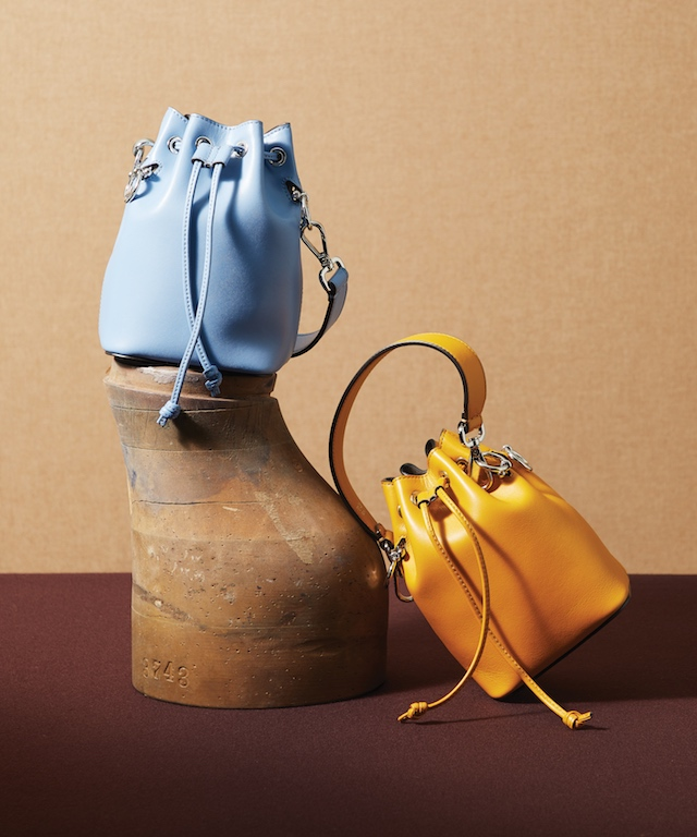 Blue Leather Mon Tresor Handbag (L); Yellow Leather Mon Tresor Handbag (R), $1,290 each