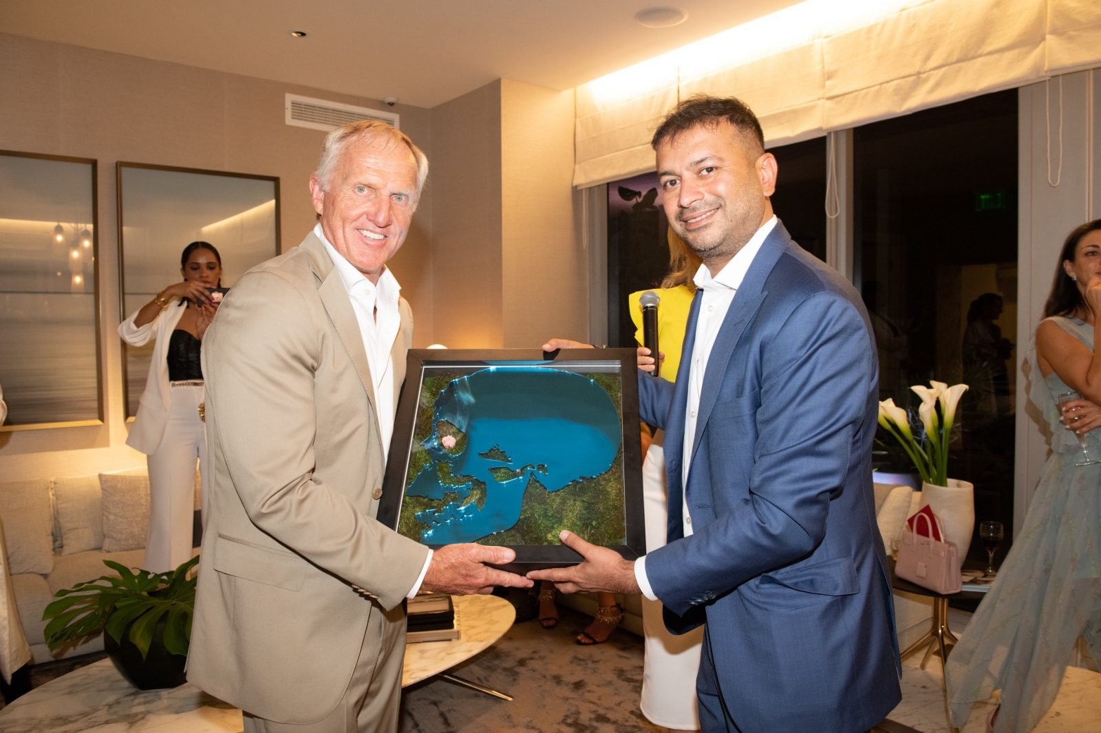 Greg Norman and Kamal Hotchandani