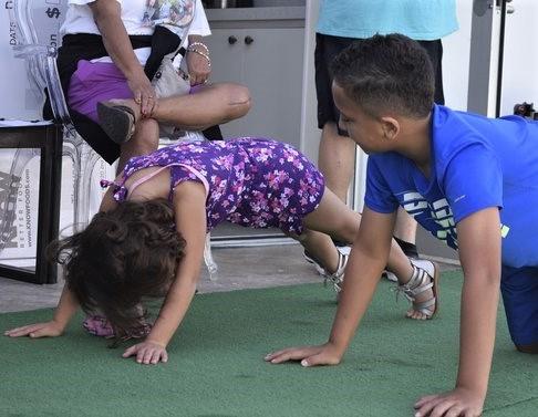 Children Participaing In Hour Push-Up Challenge