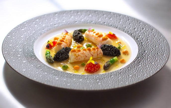 A dish of steamed scampi, ossetra caviar, shellfish gelée, and coral mayonnaise from the a la carte menu at O' by Claude Le Tohic.
