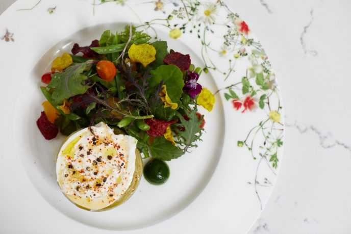 Artichoke burrata salad with haricots verts, fennel, and Marin greens, served at ONE65 Bistro & Grill.