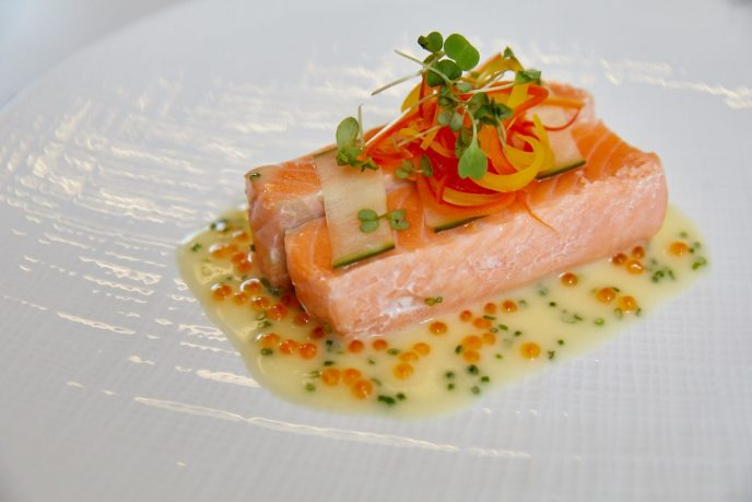 The half-smoked salmon, served with wasabi beurre blanc, bell peppers, and roe from ONE65 Bistro & Grill.