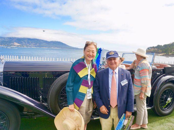 Olivia Decker with Sir Michael Kadoorie, owner of the Best of Show Bentley