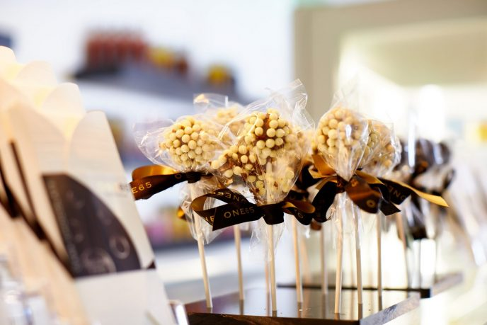 Chocolate lollipops line the counter of ONE65 Patisserie & Boutique alongside other delights, all made in-house.