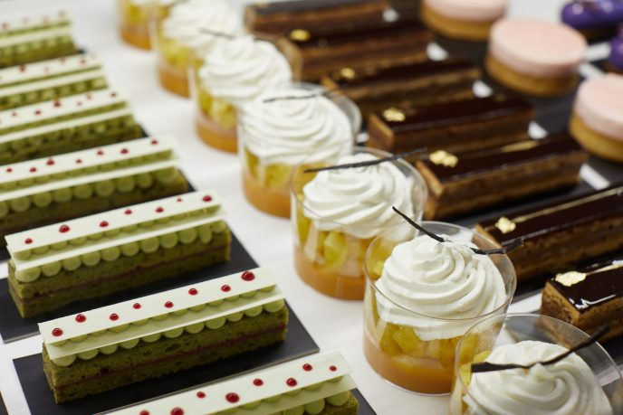 Matcha cake, rhum baba with passionfruit and vanilla whipped cream, and opera cake are featured in the pastry counter of ONE65 Patisserie & Boutique.