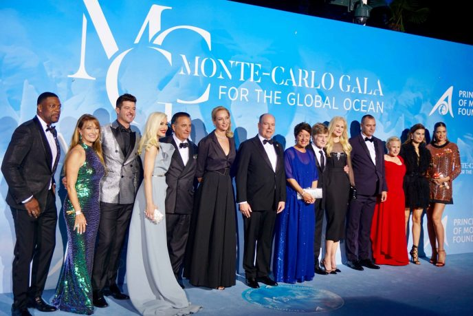 HSH Prince Albert (center) with the stars on the blue carpet.