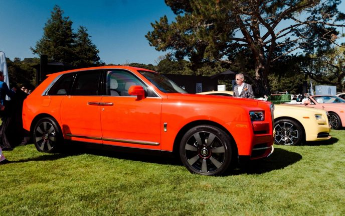 """Rolls Royce CEO, Torsten Muller-Otvos, delivered the bespoke """"Fux Orange"""" Cullinan at The Quail"""