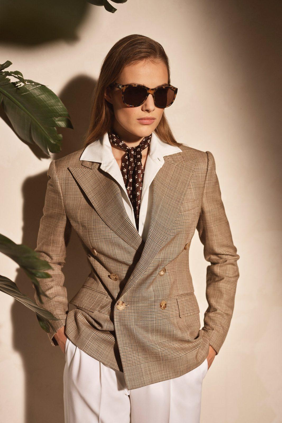 Model wearing blazer and sunglasses