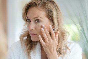Portrait,Of,Attractive,Blond,Woman,Applying,Anti-aging,Cream